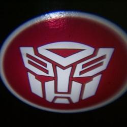 беспроводная подсветка дверей с логотипом autobots 7w беспроводная подсветка 7w